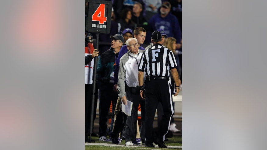 Kansas State head coach Bill Snyder looks around field judge Randy Smith to check ball placement during the second half of an NCAA college football game against Texas Tech in Manhattan, Kan., Saturday, Oct. 4, 2014. Kansas State defeated Texas Tech 45-13. (AP Photo/Orlin Wagner)