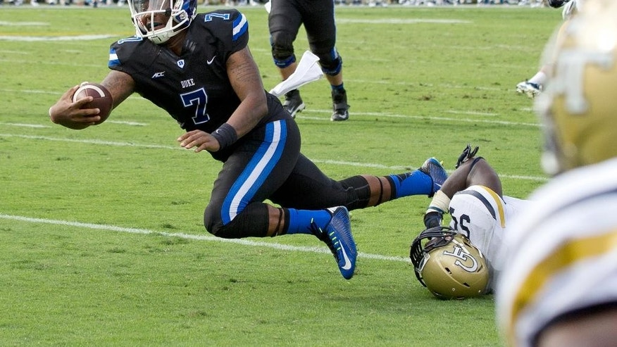Duke quarterback Anthony Boone (7) dives short of the goal line as Georgia Tech linebacker Quayshawn Nealy (54) defends during the second half of an NCAA college football game Saturday, Oct. 11, 2014, in Atlanta.  Duke won 31-25. (AP Photo/John Bazemore)
