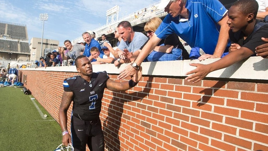 Duke quarterback Anthony Boone (7) celebrates with fans after defeating Georgia Tech 31-25 in an NCAA college football game Saturday, Oct. 11, 2014, in Atlanta.  Duke won 31-25. (AP Photo/John Bazemore)