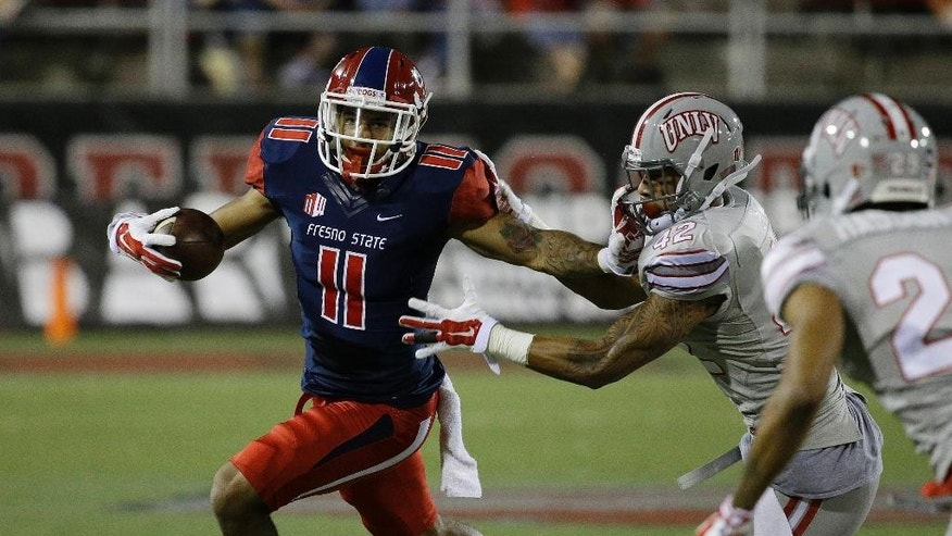 Fresno State Bulldogs wide receiver Dillon Root (11) runs for a gain against UNLV Rebels defensive back Peni Vea (42) during the first half of an NCAA college football game Friday, Oct. 10, 2014, in Las Vegas. (AP Photo/John Locher)