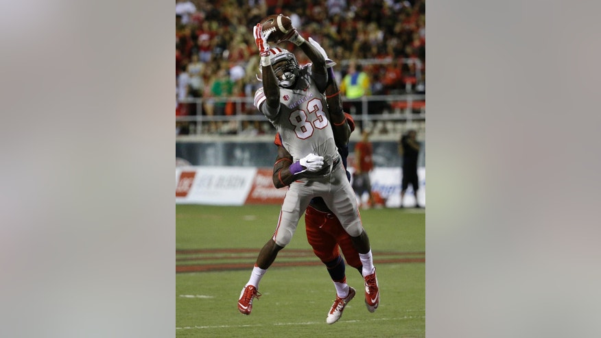 UNLV Rebels wide receiver Devonte Boyd (83) catches a pass over Fresno State Bulldogs defensive back Curtis Riley (9) during the first half of an NCAA college football game Friday, Oct. 10, 2014, in Las Vegas. (AP Photo/John Locher)