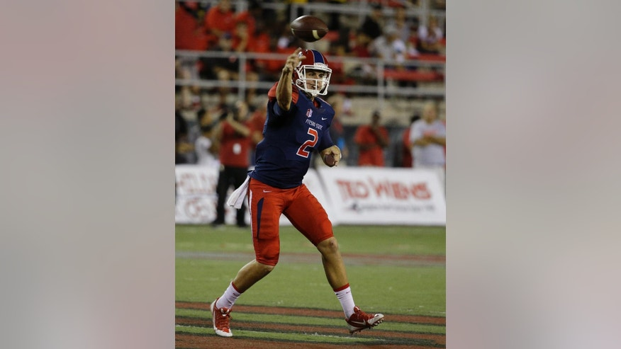 Fresno State Bulldogs quarterback Brian Burrell (2) throws the ball against UNLV Rebels during the first half of an NCAA college football game Friday, Oct. 10, 2014, in Las Vegas. (AP Photo/John Locher)