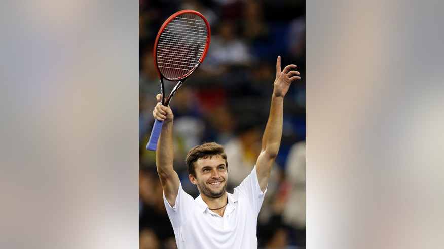 Gilles Simon of France acknowledges the crowd after defeating Feliciano Lopez of Spain during their men's singles semifinal match at the Shanghai Masters Tennis Tournament in Shanghai, China, Saturday, Oct. 11, 2014. (AP Photo/Vincent Thian)