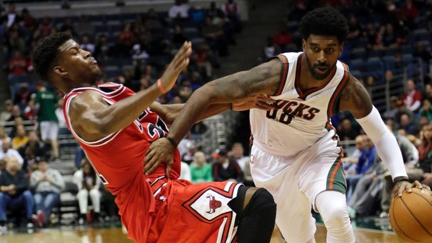 Milwaukee Bucks guard O.J. Mayo, right, drives past Chicago Bulls guard Jimmy Butler, left, during the second half of a preseason NBA game Saturday, Oct. 11, 2014, in Milwaukee. (AP Photo/Darren Hauck)