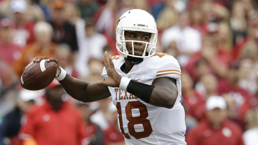 Texas quarterback Tyrone Swoopes (18) passes during the first half of an NCAA college football game against Oklahoma, Saturday, Oct. 11, 2014, in Dallas. (AP Photo/LM Otero)