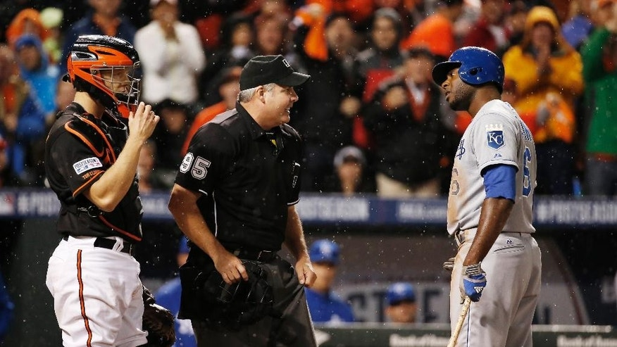 Kansas City Royals' Lorenzo Cain (6) argues a call with umpire Tim Timmons after striking out during seventh inning of Game 1 of the American League baseball championship series against the Baltimore Orioles Friday, Oct. 10, 2014, in Baltimore. (AP Photo/Alex Brandon)