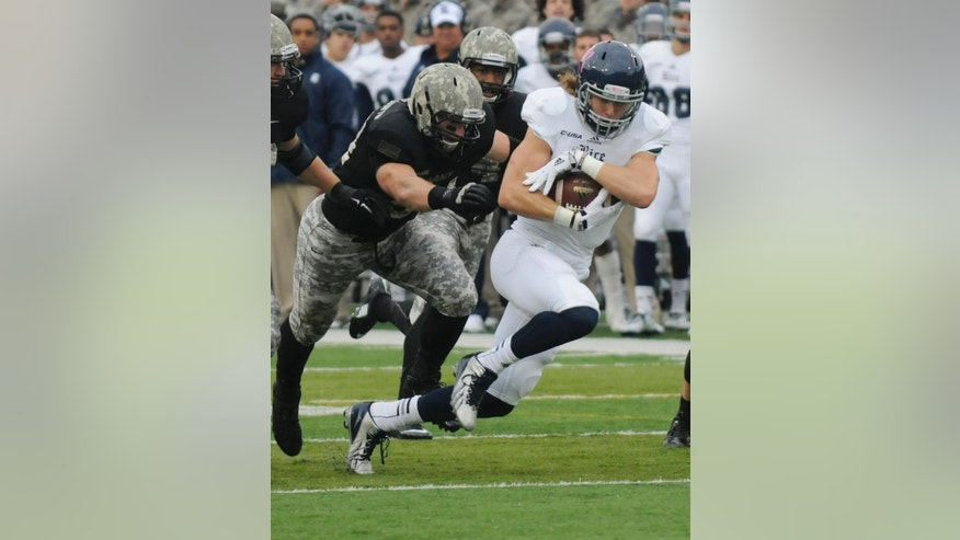 Army defensive lineman Joe Drummond (54) chases Rice wide receiver Jesse Hudak (15) during the first half of an NCAA college football game on Saturday, Oct. 11, 2014, in West Point, N.Y. (AP Photo/Hans Pennink)