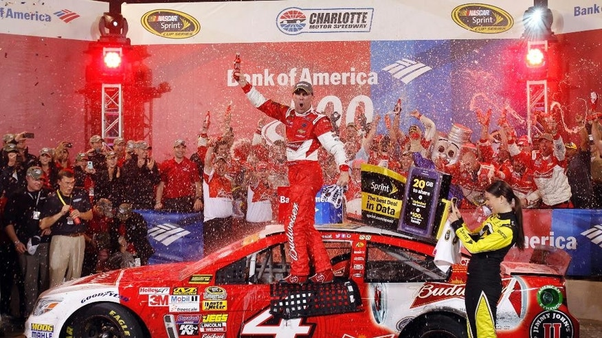 Kevin Harvick celebrates in Victory Lane after winning the NASCAR Sprint Cup series Bank of America 500 auto race at Charlotte Motor Speedway in Concord, N.C., Saturday, Oct. 11, 2014. (AP Photo/Terry Renna)