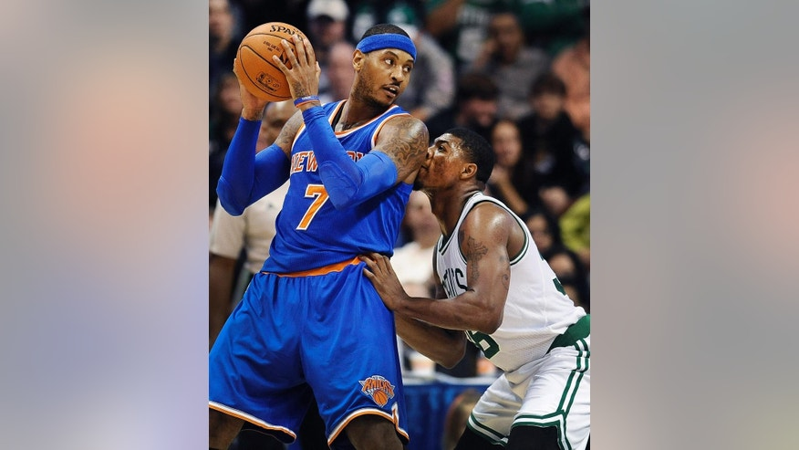 Boston Celtics guard Marcus Smart, right, guards New York Knicks forward Carmelo Anthony during the first during the first quarter of a preseason NBA basketball game, Saturday, Oct. 11, 2014, in Uncasville, Conn. (AP Photo/Jessica Hill)