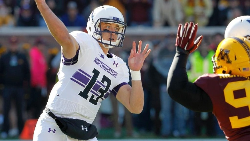 Northwestern quarterback Trevor Siemian (13) throws a pass during the first quarter of an NCAA college football game against Minnesota in Minneapolis Saturday, Oct. 11, 2014. (AP Photo/Ann Heisenfelt)