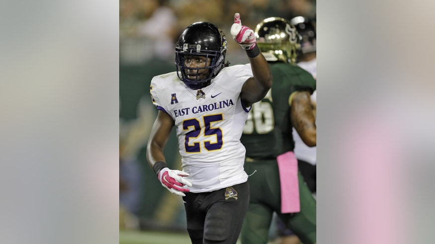 East Carolina running back Breon Allen (25) celebrates after catching a touchdown pass against South Florida during the first quarter of an NCAA college football game, Saturday, Oct. 11, 2014, in Tampa, Fla. (AP Photo/Chris O'Meara)