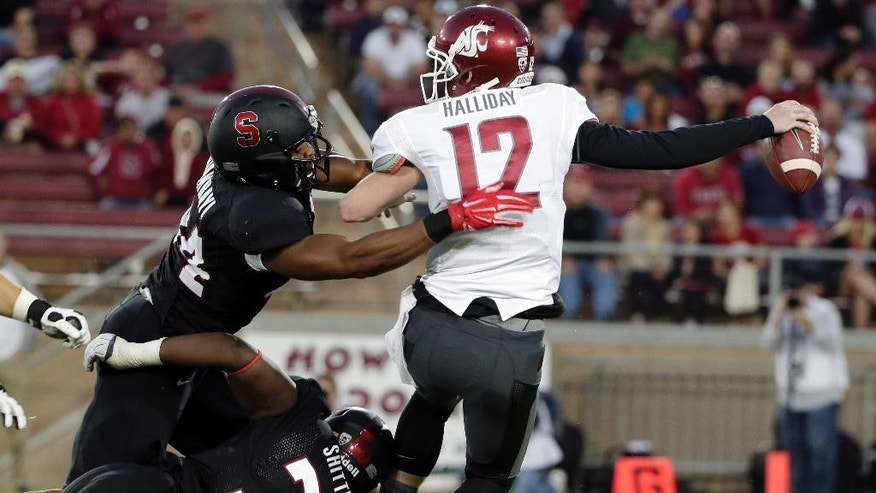 Washington State quarterback Connor Halliday (12) is sacked by Stanford linebacker Peter Kalambayi, top left, during the first half of an NCAA college football game on Friday, Oct. 10, 2014, in Stanford, Calif. (AP Photo/Marcio Jose Sanchez)