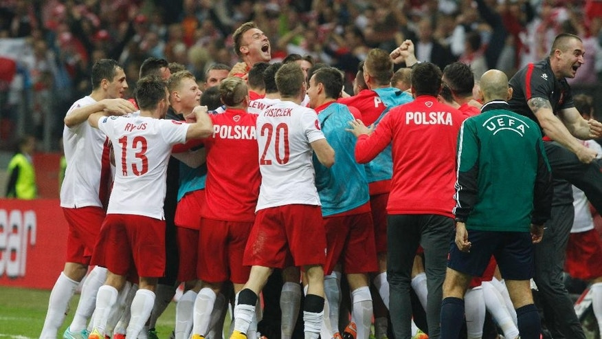 The Polish team celebrates after scoring their second goal during a Euro 2016 group D qualifying soccer match between Poland and Germany in Warsaw, Poland,Saturday, Oct. 11, 2014. (AP Photo/Czarek Sokolowski)
