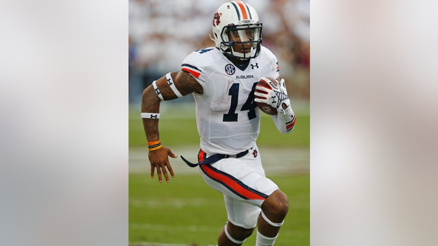 Auburn quarterback Nick Marshall (14) runs for a gain during the first half of an NCAA college football game against Mississippi State in Starkville, Miss., Saturday, Oct 11, 2014.(AP Photo/Rogelio V. Solis)