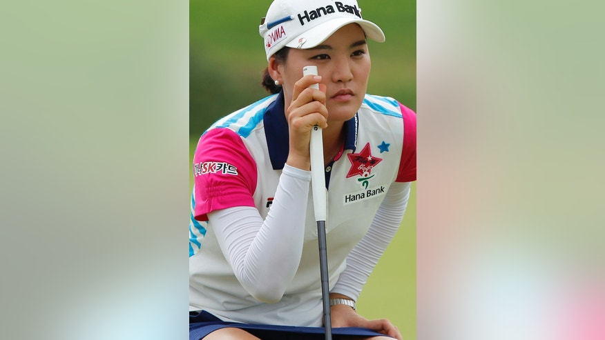 So Yeon Ryu of South Korea lines up her putt on the 2nd green during the third round of the LPGA Malaysia golf tournament at Kuala Lumpur Golf and Country Club in Kuala Lumpur, Malaysia, Saturday, Oct. 11, 2014. (AP Photo/Lai Seng Sin)