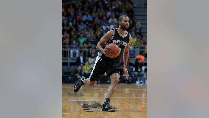 San Antonio Spurs' Tony Parker from France controls the ball during an NBA Global Games basketball match between San Antonio Spurs and Turkey's Fenerbahce Ulker, in Istanbul, Turkey, Saturday, Oct. 11, 2014. (AP Photo)