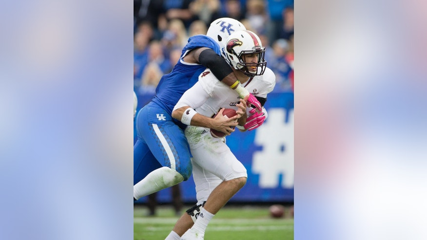 Kentucky defensive end Alvin Dupree tackles Louisiana Monroe quarterback Pete Thomas during the first half of the of an NCAA college football game in Lexington, Ky., Saturday, Oct. 11, 2014. (AP Photo/David Stephenson)