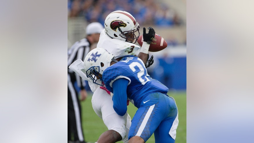 Kentucky cornerback Blake McClain breaks up a pass to Louisiana Monroe running back Tyler Cain during the first half of the of an NCAA college football game at Commonwealth Stadium in Lexington, Ky., Saturday, Oct. 11, 2014. (AP Photo/David Stephenson)