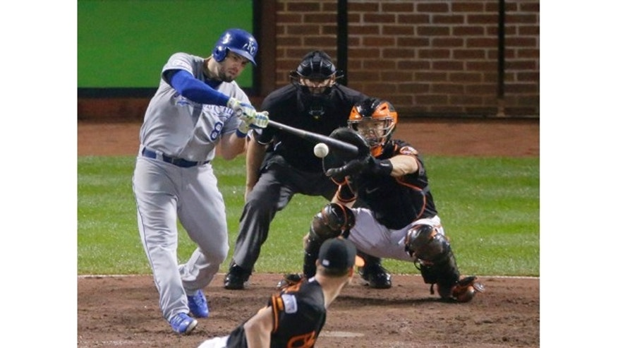 October 11, 2014: Kansas City Royals' Mike Moustakas (8) hits a two-run home run during the 10th inning of Game 1 of the American League baseball championship series against the Baltimore Orioles. (AP Photo/Charlie Riedel)