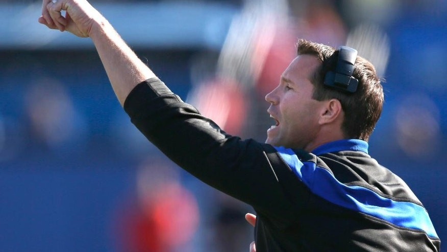 Kansas head coach Clint Bowen signals his team during the first half of an NCAA college football game against Oklahoma State in Lawrence, Kan., Saturday, Oct. 11, 2014. (AP Photo/Orlin Wagner)