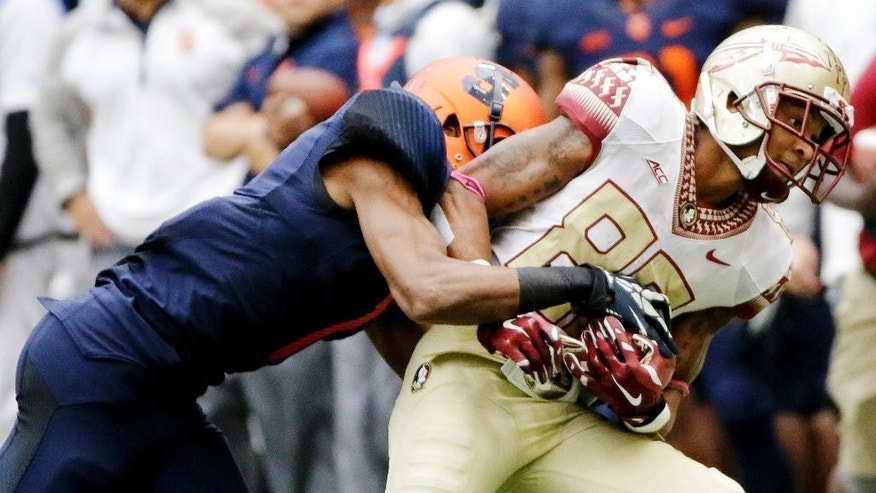 Florida State wide receiver Rashad Greene (80) is forced out-of-bounds by Syracuse's Julian Whigham (1) after making a catch during the second half of an NCAA college football game Saturday, Oct. 11, 2014, in Syracuse, N.Y. (AP Photo/Frank Franklin II)