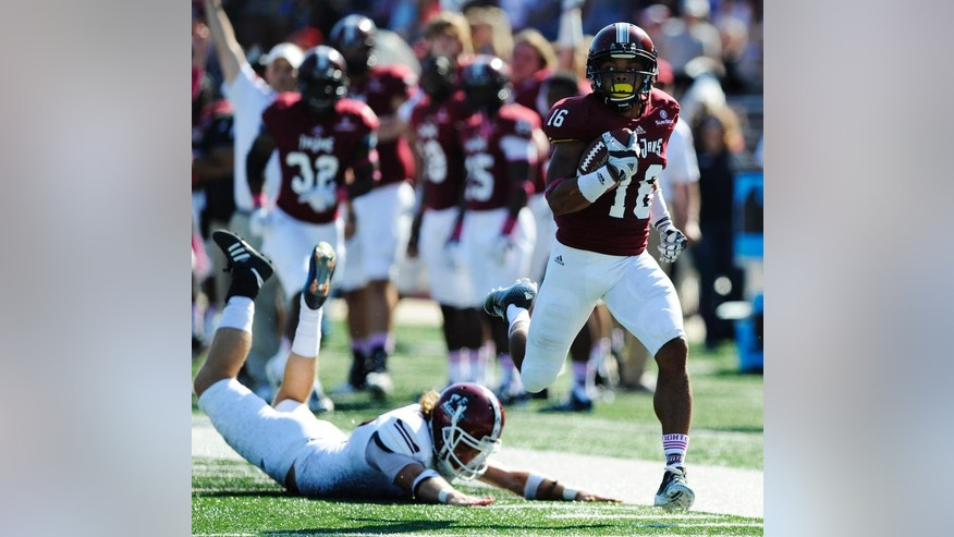 Troy wide receiver Chandler Worthy (16) runs past New Mexico State defender Maxwell Johnson during an NCAA college football game in Troy, Ala., on Saturday, Oct. 11, 2014. (AP Photo/The Montgomery Advertiser, Mickey Welsh)