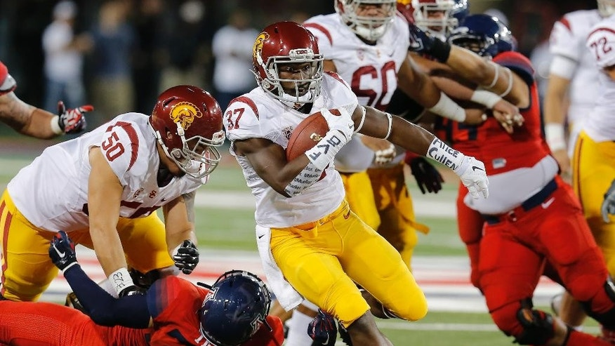 Southern California running back Javorius Allen (37) scores a touchdown during the first half of an NCAA college football game against Arizona, Saturday, Oct. 11, 2014, in Tucson, Ariz. (AP Photo/Rick Scuteri)