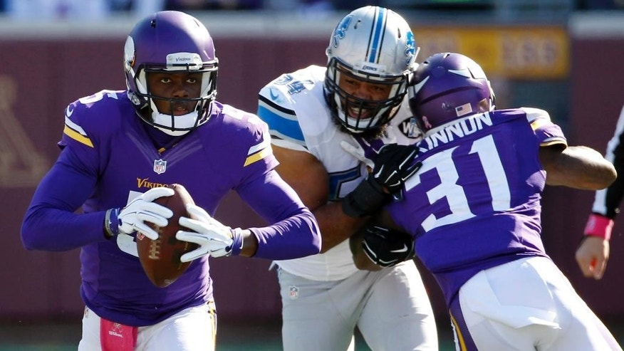 Detroit Lions outside linebacker DeAndre Levy (54) is pushed by Minnesota Vikings running back Jerick McKinnon (31) as Vikings quarterback Teddy Bridgewater scrambles during the first half of an NFL football game Sunday, Oct. 12, 2014, in Minneapolis. (AP Photo/Ann Heisenfelt)