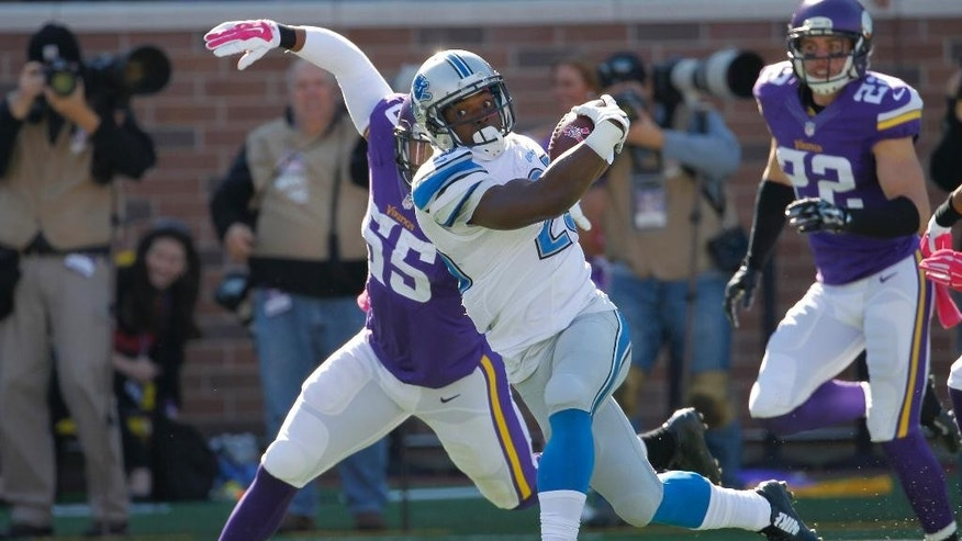 Detroit Lions running back Theo Riddick (25) is brought down by Minnesota Vikings outside linebacker Anthony Barr (55) during the first half of an NFL football game Sunday, Oct. 12, 2014, in Minneapolis. (AP Photo/Ann Heisenfelt)