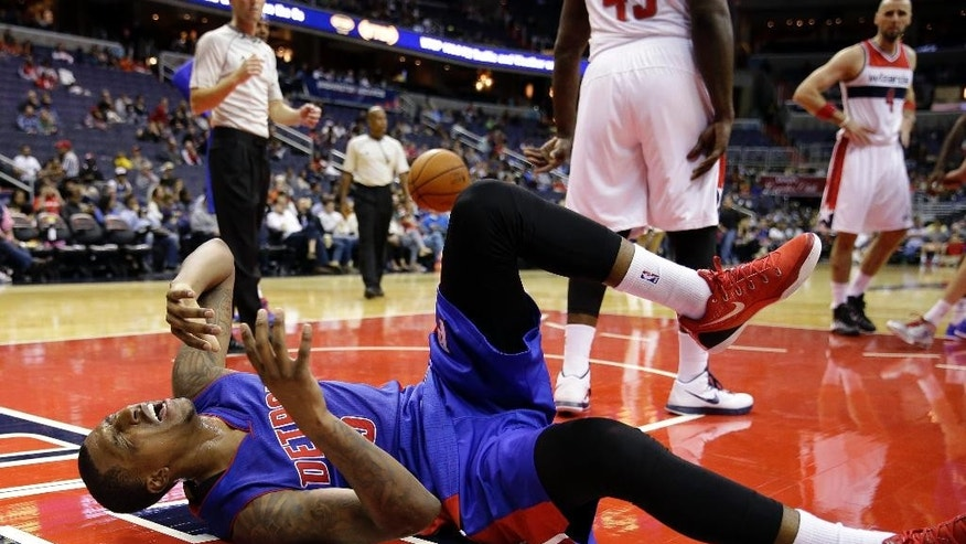 Detroit Pistons guard Kentavious Caldwell-Pope reacts after falling in the second half of a preseason NBA basketball game against the Washington Wizards, Sunday, Oct. 12, 2014, in Washington. The Wizards won 91-89. (AP Photo/Alex Brandon)
