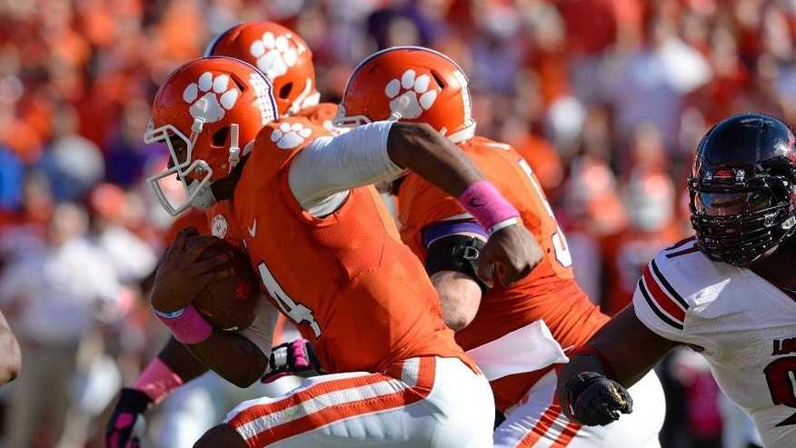Clemson quarterback Deshaun Watson rushes out of the pocket during an NCAA college football game against Louisville  in Clemson, S.C.,  Saturday, Oct. 11, 2014. (AP Photo/ Richard Shiro)