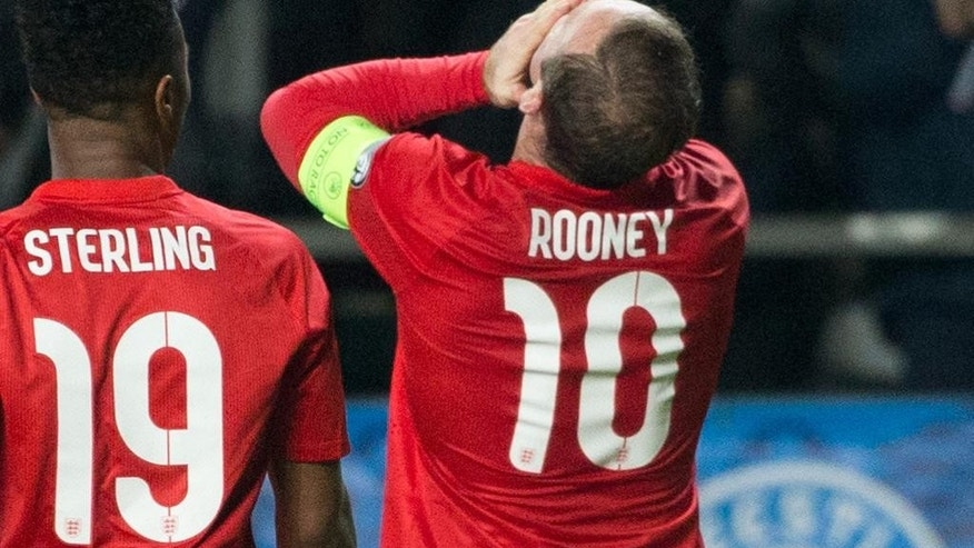 England's Wayne Rooney celebrates after scoring a goal during the Euro 2016 qualifying soccer match between Estonia and England in Tallinn, Estonia, Sunday, Oct. 12, 2014. (AP Photo/Liis Treimann)