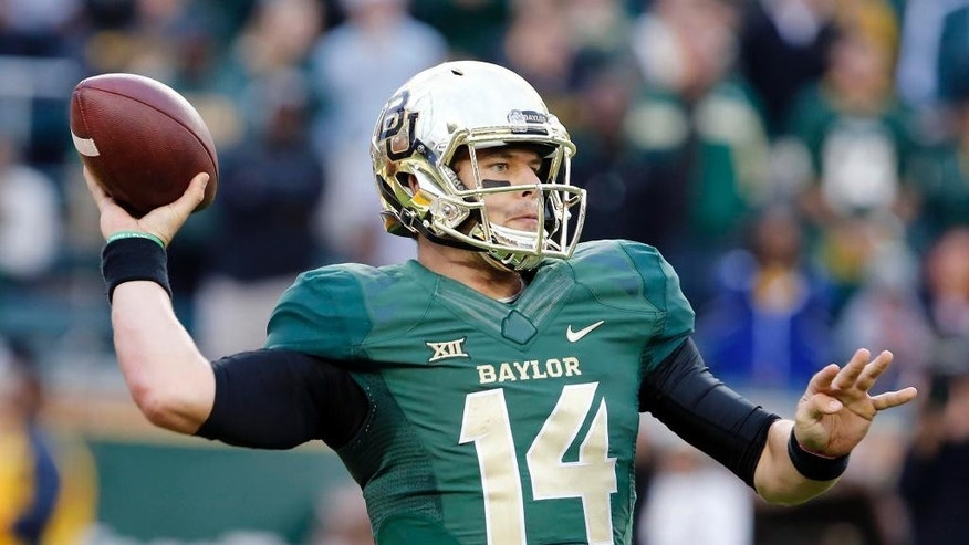 Baylor quarterback Bryce Petty throws against TCU in the second half of an NCAA college football game, Saturday, Oct. 11, 2014, in Waco, Texas. (AP Photo/Waco Tribune Herald, Rod Aydelotte)