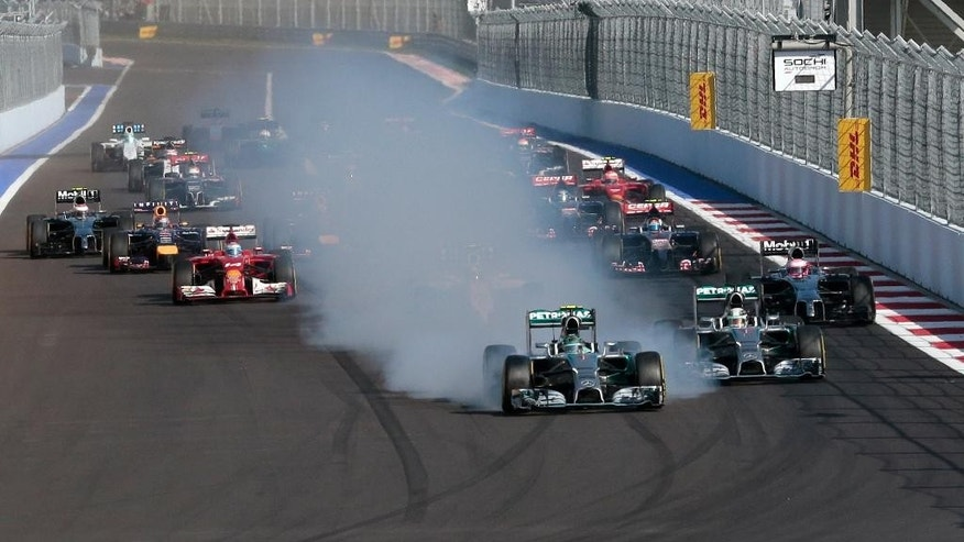 Mercedes driver Nico Rosberg of Germany brakes leading the pack at the start of the Formula One Russian Grand Prix at the 'Sochi Autodrom' Formula One circuit, in Sochi, Russia, Sunday, Oct. 12, 2014. (AP Photo/Ivan Sekretarev)