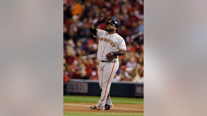 San Francisco Giants' Pablo Sandoval reacts after hitting a single during the third inning in Game 1 of the National League baseball championship series against the St. Louis Cardinals Saturday, Oct. 11, 2014, in St. Louis. (AP Photo/Jeff Roberson)