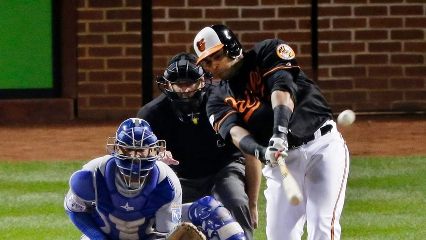 Baltimore Orioles' Nelson Cruz (23) hits an RBI double during the fifth inning of Game 1 of the American League baseball championship series against the Kansas City Royals Friday, Oct. 10, 2014, in Baltimore. (AP Photo/Charlie Riedel)