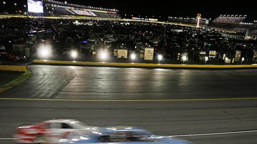Brad Keselowski (2) and Kevin Harvick (4) race out of Turn 3 during the NASCAR Sprint Cup series Bank of America 500 auto race at Charlotte Motor Speedway in Concord, N.C., Saturday, Oct. 11, 2014. (AP Photo/Chuck Burton)