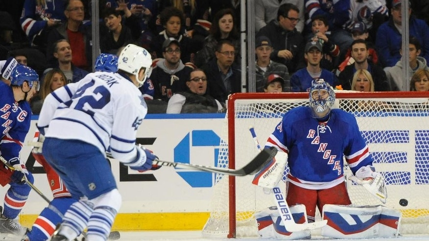 Toronto Maple Leafs' Tyler Bozak (42) watches the puck he shot go past New York Rangers goalie Henrik Lundqvist (30) to score in the second period of an NHL hockey game at Madison Square Garden on Sunday, Oct. 12, 2014, in New York. (AP Photo/Kathy Kmonicek)