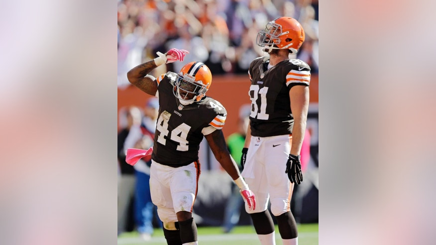 Cleveland Browns running back Ben Tate (44) celebrates a touchdown run against the Pittsburgh Steelers with tight end Jim Dray (81) in the fourth quarter of an NFL football game Sunday, Oct. 12, 2014, in Cleveland. (AP Photo/Tony Dejak)