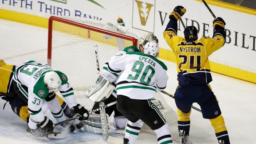Nashville Predators left wing Eric Nystrom (24) scores against the Dallas Stars as Jason Spezza (90) and Alex Goligoski (33) defend in the third period of an NHL hockey game Saturday, Oct. 11, 2014, in Nashville, Tenn. (AP Photo/Mark Humphrey)