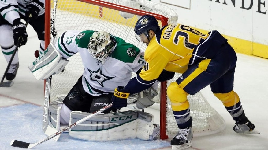 Nashville Predators center Paul Gaustad (28) scores against Dallas Stars goalie Anders Lindback (29), of Sweden, in the third period of an NHL hockey game Saturday, Oct. 11, 2014, in Nashville, Tenn. (AP Photo/Mark Humphrey)