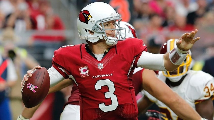 Arizona Cardinals quarterback Carson Palmer (3) throws against the Washington Redskins during the first half of an NFL football game, Sunday, Oct. 12, 2014, in Glendale, Ariz.(AP Photo/Rick Scuteri)