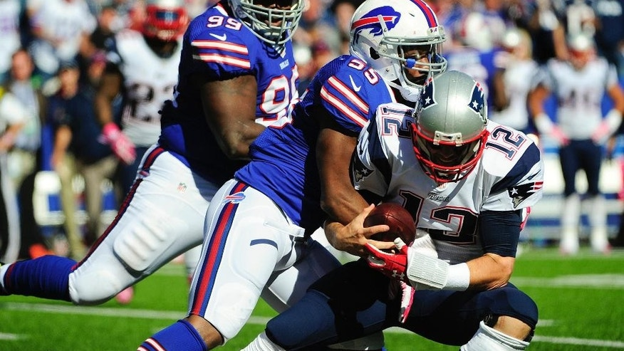 Buffalo Bills defensive end Jerry Hughes (55) sacks New England Patriots quarterback Tom Brady (12) during the first half of an NFL football game Sunday, Oct. 12, 2014, in Orchard Park, N.Y. (AP Photo/Gary Wiepert)