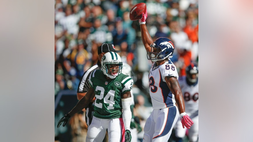 Denver Broncos wide receiver Demaryius Thomas (88) reacts after catching a touchdown pass against New York Jets defensive back Phillip Adams (24) in the second quarter of an NFL football game, Sunday, Oct. 12, 2014, in East Rutherford, N.J. (AP Photo/Kathy Willens)