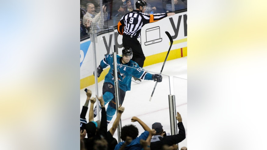 San Jose Sharks center Patrick Marleau celebrates his goal against the Winnipeg Jets during the second period of an NHL hockey game Saturday, Oct. 11, 2014, in San Jose, Calif. (AP Photo/Marcio Jose Sanchez)
