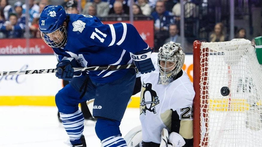 Pittsburgh Penguins goaltender Marc-Andre Fleury is screened by Toronto Maple Leafs David Clarkson on a shot during the second period of an NHL hockey game, Saturday, Oct. 11, 2014 in Toronto. (AP Photo/The Canadian Press, Frank Gunn)