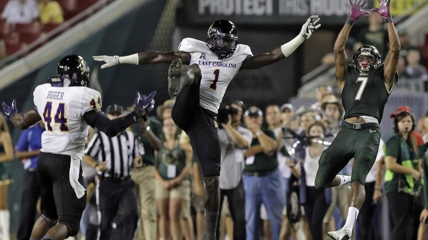South Florida wide receiver Andre Davis (7) goes up for a reception in front of East Carolina linebacker Dayon Pratt (1) and linebacker Zeek Bigger (44) during the fourth quarter of an NCAA college football game, Saturday, Oct. 11, 2014, in Tampa, Fla. (AP Photo/Chris O'Meara)