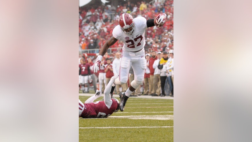 Alabama running back Derrick Henry (27) leaps past Arkansas cornerback Jared Collins in the second quarter of an NCAA college football game in Fayetteville, Ark., Saturday, Oct. 11, 2014. (AP Photo/David Quinn)