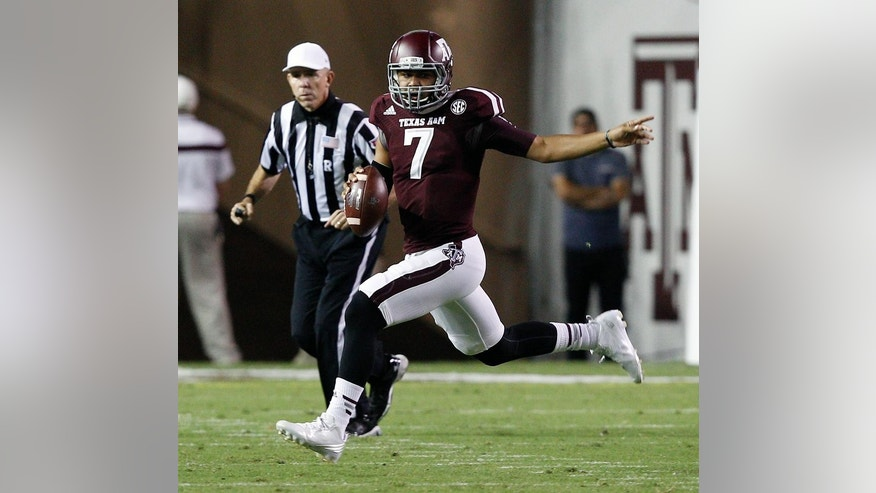 Texas A&M quarterback Kenny Hill scrambles out of the pocket during the second quarter of an NCAA college football game against Mississippi, Saturday, Oct. 11, 2014, in College Station, Texas. (AP Photo/Bob Levey)