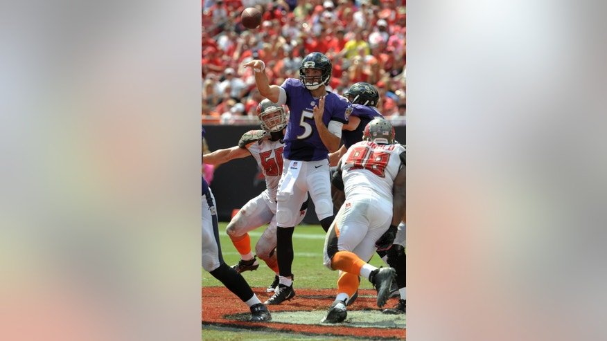 Baltimore Ravens quarterback Joe Flacco (5) throws a pass as he is pressured by Tampa Bay Buccaneers defensive tackle Clinton McDonald (98) during the first half of an NFL football game in Tampa, Fla., Sunday, Oct. 12, 2014. (AP Photo/Steve Nesius)